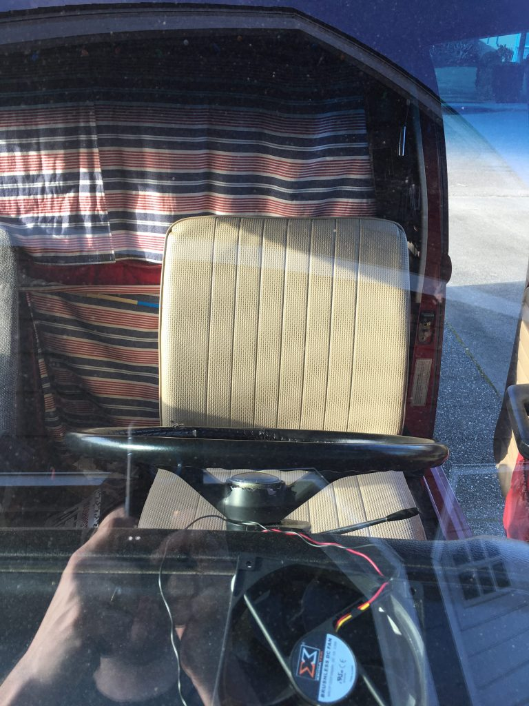 The seat in the bus looking at it through the front windshield. Mostly square.