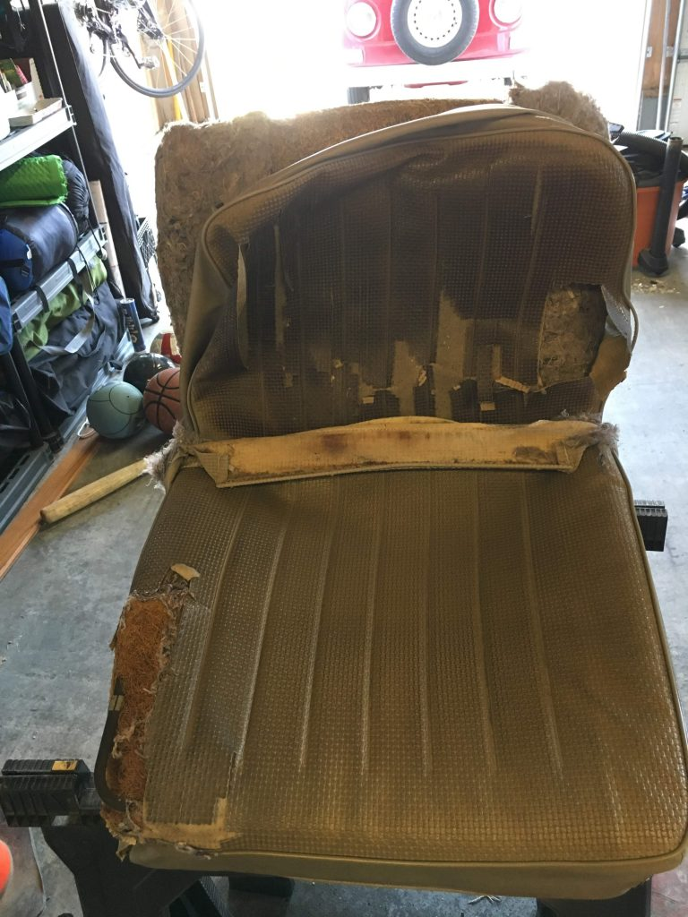 A '71 VW Van seat with a torn corner and pretty much no more padding on the seat.